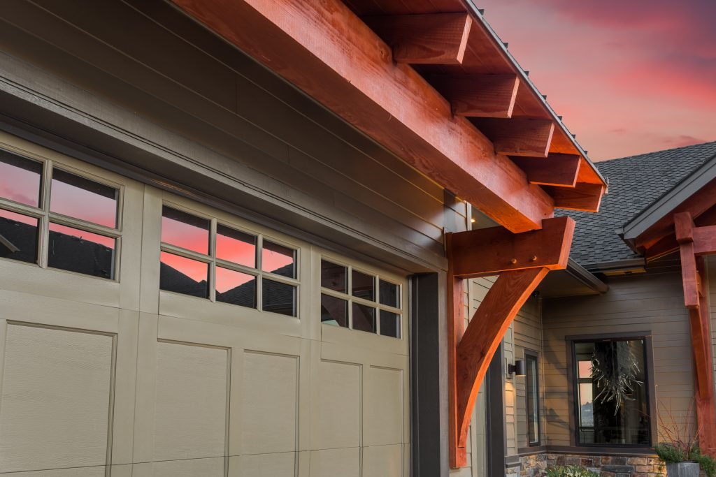 Garage Door with Partial View of Front Entrance and Colorful Sunset Sky