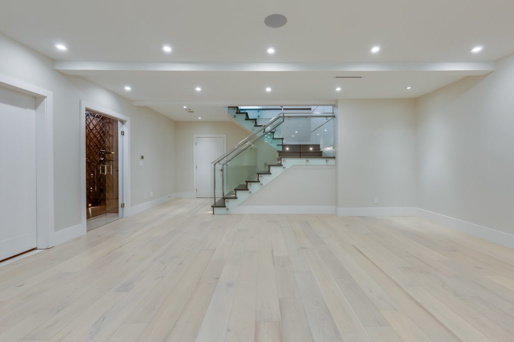 Luxury basement flooring. Interior design of a lower level room in a newly built house for use as a game room or party room.